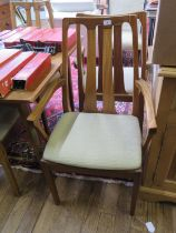 A set of six teak dining chairs by Nathan, including two carvers, with open splat backs, and a