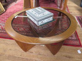 A G-Plan teak circular coffee table, with smoked glass top, 83.5 cm diameter