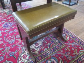 A mahogany organ stool, with leather overstuffed hinged seat, 68 x 43 cm, 56 cm high