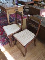 A pair of Regency brass inlaid rosewood dining chairs, the scroll carved backs over later drop-in