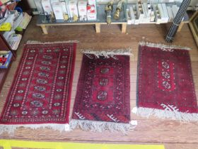 Three small Bokhara style rugs, with single row of guls on red grounds, largest 102 x 60 cm