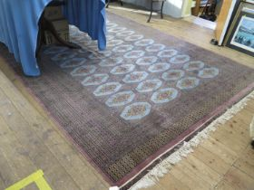 An Afghan blue ground carpet, with four rows of medallions within a multiple border, 333 x 226 cm