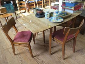 A 1950s G-Plan 'Brandon' range teak dining room suite, comprising a drop leaf table with four dining