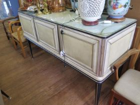 A cream and black faux leather dining room suite by Umberto Mascagni, the sideboard with mirrored