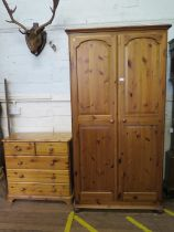 A pine twin door wardrobe, 97 cm wide, 54cm deep, 184 cm high, and a similar chest of two short