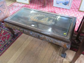 An Anglo-Chinese carved wood coffee table, the top carved with sailing vessels on a coastline, on