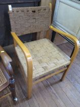 A carver chair, with interwoven rush back and seat and curved arms