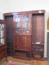 A mahogany breakfront bookcase cabinet, the moulded cornice over a pair of glazed doors above