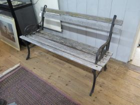 A cast iron and wood garden bench, 123cm