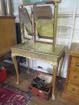 A George I style gilt wood dressing table, the triptych mirror over a foliate scroll decorated top