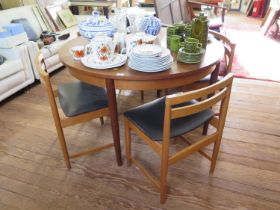 A teak extending circular dining table, and four dining chairs, 120 cm wide (5)