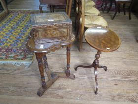 An oak trefoil form occasional table, the moulded top on stop fluted supports joined by