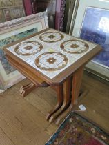 A G-Plan teak nest of three tables, the largest with tiled top, 49 cm wide