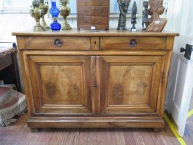 A 19th century French cherrywood buffet or sideboard, with two frieze drawers over a pair of