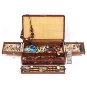 A LEATHER JEWELLERY CASE with fitted interior by Finnigans of New Bond Street, contents to include a