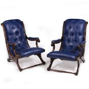 A PAIR OF BLUE LEATHER BUTTON UPHOLSTERED ARMCHAIRS with mahogany frames, 63cm wide x 92cm deep x
