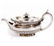 A WILLIAM IV SILVER TEAPOT of squat form with reeded decoration, marks for London 1827, 29cm wide