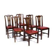 A SET OF SIX EARLY 20TH CENTURY MAHOGANY DINING CHAIRS with pierced splats and leatherette