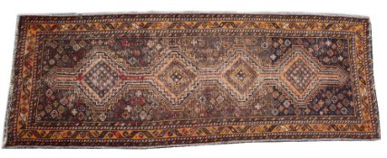 A MIDDLE EASTERN RED AND ORANGE GROUND RUG with a banded border and geometric decoration, 101cm x