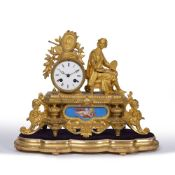 A 19TH CENTURY FRENCH GILT METAL MANTLE CLOCK with an inset painted porcelain panel and enamelled
