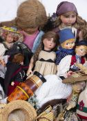 A COLLECTION OF DOLLS At present, there is no condition report prepared for this lot This in no