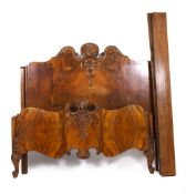 AN EARLY TO MID 20TH CENTURY BURR WALNUT VENEERED KING SIZE DOUBLE BED with scrolling cabriole feet,