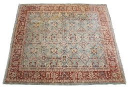 A MODERN ORIENTAL GREEN GROUND RUG with floral decoration and multiple banded border, 290cm x