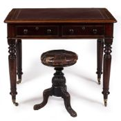 A VICTORIAN MAHOGANY WRITING TABLE with a later maroon leather inset top, two frieze drawers with