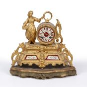 A 19TH CENTURY CONTINENTAL GOLD PAINTED SPELTER MANTLE CLOCK the dial and case set with flower