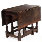 AN ANTIQUE OAK DROP LEAF TABLE with turned legs united by stretchers, possibly 17th century, 87cm