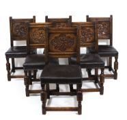 A SET OF SIX 17TH CENTURY STYLE OAK DINING CHAIRS circa 1920 with chip carved panel backs, leather