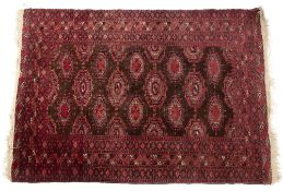 AN AFGHAN RED GROUND RUG 128cm x 190cm Condition: with some minor repairs, minimal wear, moderate