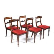 A SET OF FIVE REGENCY ROSEWOOD DINING CHAIRS with bar backs and inset seats, 46cm wide x 86cm high