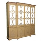 A MODERN CREAM PAINTED BREAKFRONT CABINET with four mirrored doors above four panelled doors and