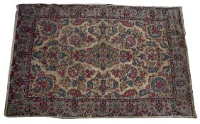 A PERSIAN STYLE CREAM GROUND CARPET with floral decoration, 210cm x 320cm Condition: in relatively