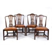 A SET OF FOUR MAHOGANY DINING CHAIRS with brown leather inset seats, 55cm wide x 94cm high