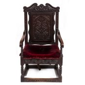 AN ANTIQUE CARVED OAK WAINSCOT CHAIR 60.5cm wide x 64cm deep x 112cm high Condition: later seat