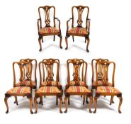 A SET OF TEN CHERRYWOOD GEORGIAN STYLE DINING CHAIRS with pierced splats and inset seats upholstered