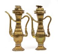 A PAIR OF ANTIQUE CHINESE BRASS WINE EWERS of hexagonal section, each spout cast with a dragons
