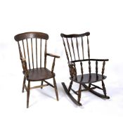 A STICK BACK WINDSOR ARMCHAIR together with a dark stained wooden rocking chair (2) Condition: minor