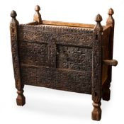 AN ANTIQUE AFGHAN CARVED WOODEN DOWRY CHEST of panel construction, the front with chip carved