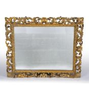 A LARGE GILDED WOODEN GESSO WALL MIRROR with acanthus scrolls, 128cm wide x 103cm high Condition: