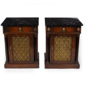 A PAIR OF EMPIRE STYLE MAHOGANY BEDSIDE CABINETS with faux marble tops, single drawers, a cupboard