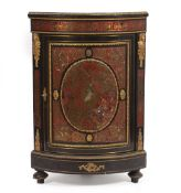 A 19TH CENTURY FRENCH EBONISED TORTOISE SHELL AND BRASS INLAID BOULLE CORNER CABINET with gilt