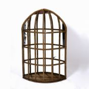 AN UNUSUAL GILDED WALL MIRROR of caged form, 60cm wide x 98cm high Condition: some losses to the