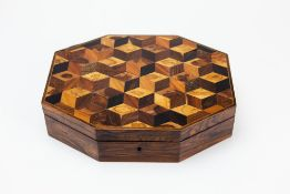 A 19TH CENTURY SPECIMEN WOOD PARQUETRY WORKBOX of octagonal form, 28cm wide x 21.5cm deep x 7cm high