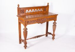 A LATE 19TH CENTURY GOTHIC STYLE OAK SIDE TABLE with a galleried back, single frieze drawer,