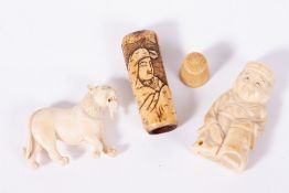 A 19TH CENTURY CARVED IVORY NETSUKE in the form of a kneeling man; a 19th century Oriental carved