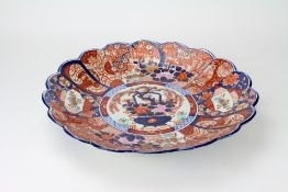 A LATE 19TH CENTURY JAPANESE IMARI CHARGER with a shaped border, 45.5cm diameter Condition: hairline