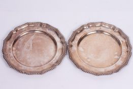 A PAIR OF SILVER PLATED PLATES by Carrington & Co, each with shaped and gadrooned edges, marked M.